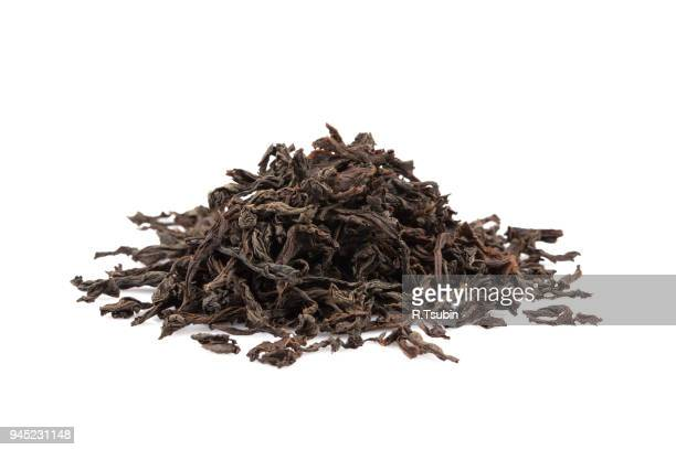 black dry tea leaves - tea leaves stock photos and pictures