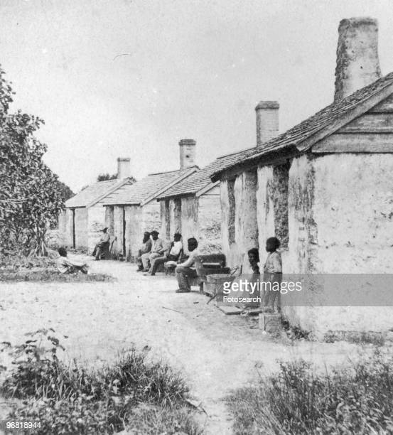 Black Slaves sit outside of their Quarters in Ft George Island Florida circa 1850