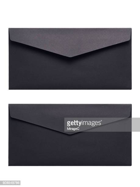 black envelope on white background - envelope stock pictures, royalty-free photos & images