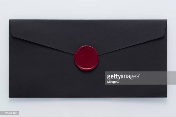 black envelope sealed with wax stamp - 封筒 ストックフォトと画像