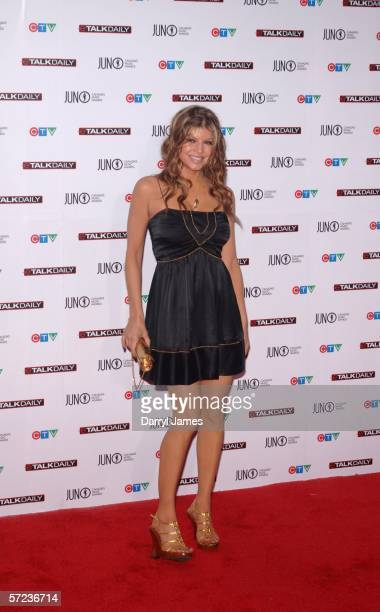 Black Eyed Peas' Fergie arrives on the red carpet for the 2006 Juno Awards April 2 2006 in Halifax Nova Scotia Canada