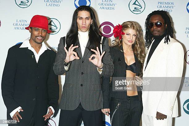 Black Eyed Peas pose backstage during the 4th Annual Latin Grammy Awards at the AmericanAirlines Arena on September 3 2003 in Miami Florida