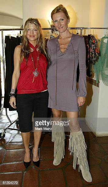 Black Eyed Peas singer Fergie and designer designer Nina Morris attend the Nina Morris Trunk Show at Patric Reeves' home August 21 2004 in Los Feliz...