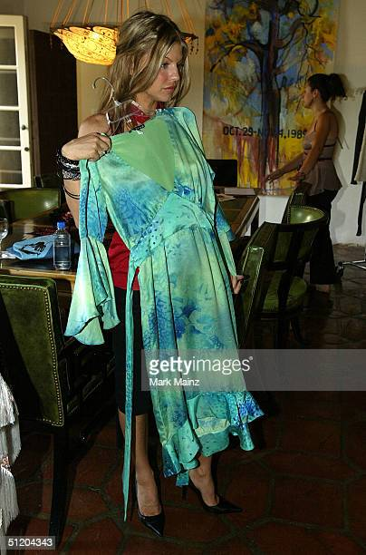 Black Eyed Peas singer Fergie attends the Nina Morris Trunk Show at Patric Reeves' home August 21 2004 in Los Feliz California
