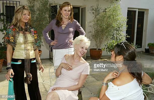 Black Eyed Peas singer Fergie Patric Reeves and musician Noa Tishby attend the Nina Morris Trunk Show at Patric Reeves' home August 21 2004 in Los...
