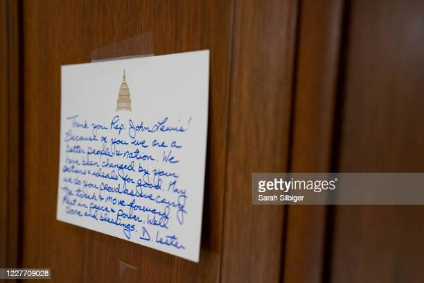 Black fabric and notes adorn the office door of civil rights activist Rep. John Lewis , who died last week, on July 20, 2020 in the Cannon House...