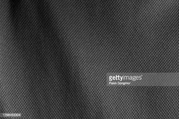 black fabric cloth polyester texture background. - tessuto a rete foto e immagini stock