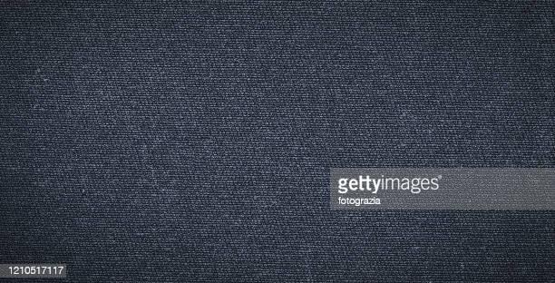 black fabric - black jeans foto e immagini stock