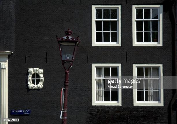 black facade in amsterdam - brick house stock pictures, royalty-free photos & images