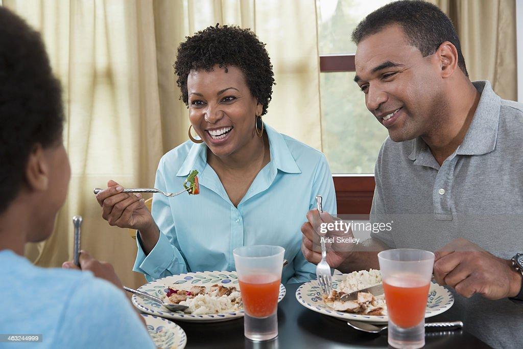 Black Family Eating Dinner Together Stock Photo
