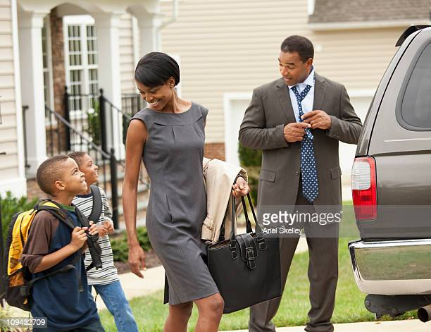 Black family getting into car in the morning