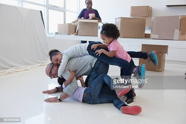 Black family playing in new home