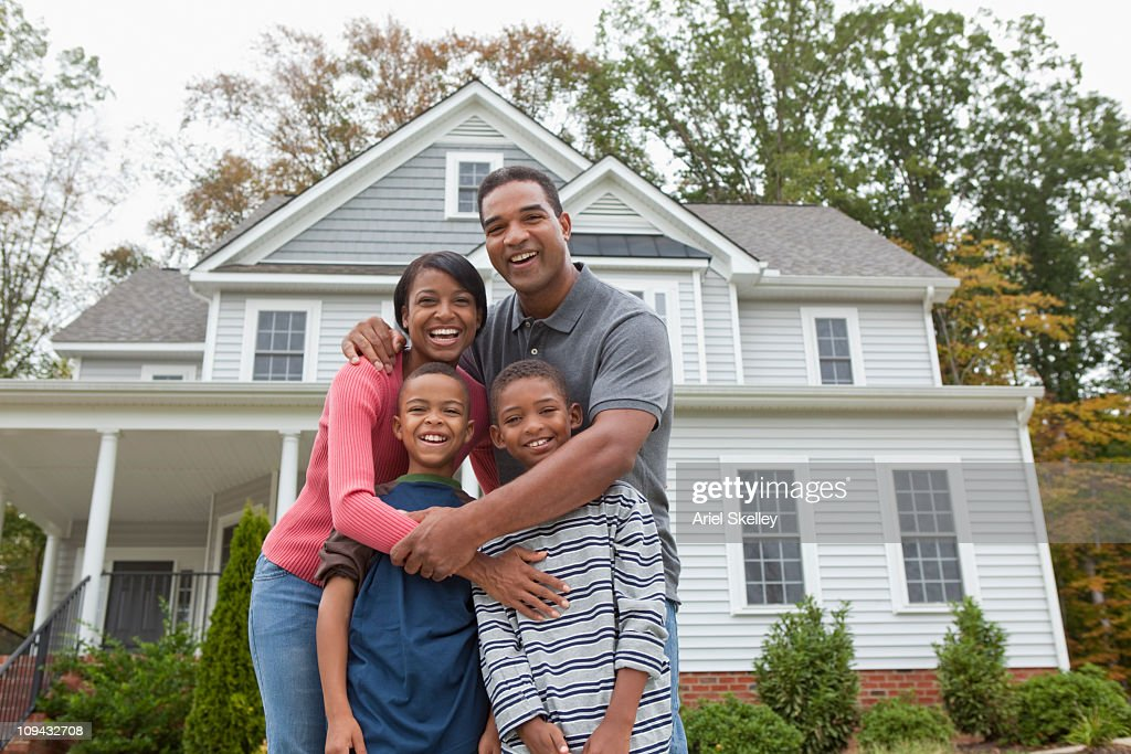 black family standing together in front of house stock photo getty images. Black Bedroom Furniture Sets. Home Design Ideas