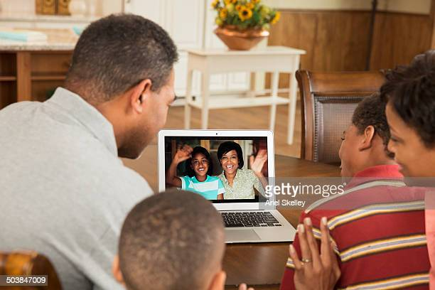 Black family video conferencing with relatives