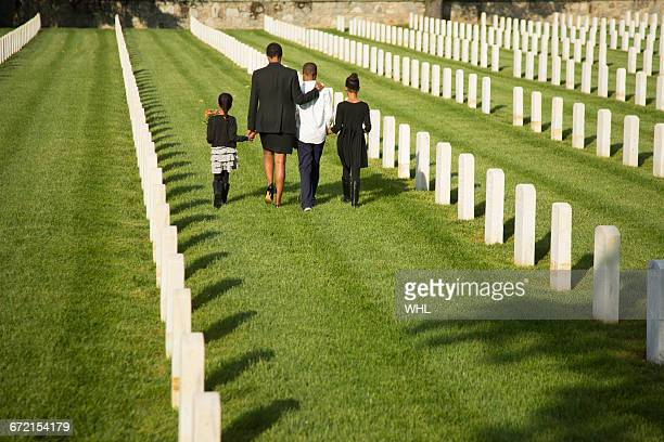 Black family walking in military cemetery