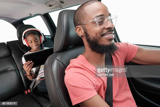 black father and daughter driving in car - family driving stock photos and pictures