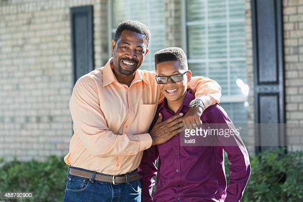 Black father and teenage son outdoors