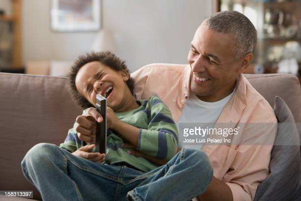 Black father holding son on lap