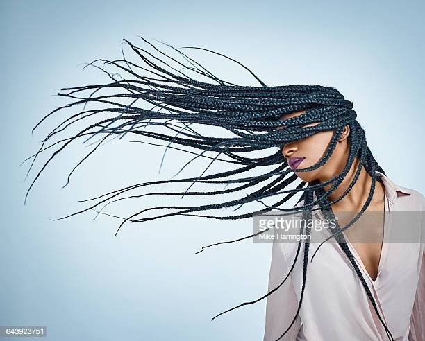 black female flicking hair - braided stock pictures, royalty-free photos & images