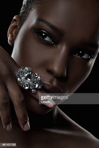 black female model wearing luxury ring