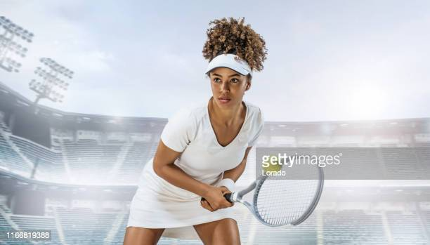 a black female tennis player in a stadium - tennis tournament stock pictures, royalty-free photos & images