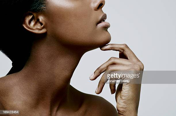 black female touching her chin - beauty stock pictures, royalty-free photos & images