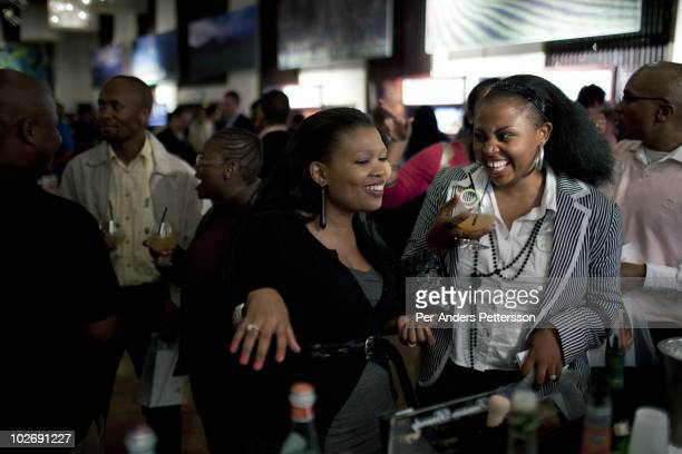 Black female yuppies try brandy at the yearly Brandy festival at Sandton Sun hotel on May 7 in Johannesburg, South Africa. Many wealthy blacks wants...