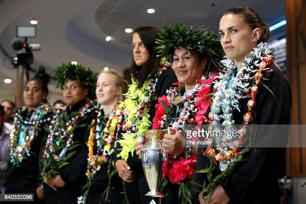 Black Ferns captain Fiao'o Faamausili holds the trophy as the New Zealand Black Ferns are welcomed home at Auckland International Airport on August...