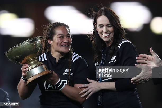 Black Ferns captain Fiao'o Faamausili is presented with the trophy from Prime Minister Jacinda Ardern during the International Test match between the...