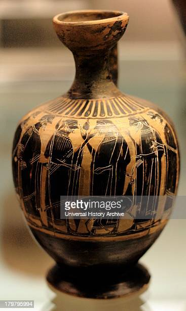 Black- figured Lakythos : a group of men, two with spears, and a deer Made in Athens about 540-520 From Athens.