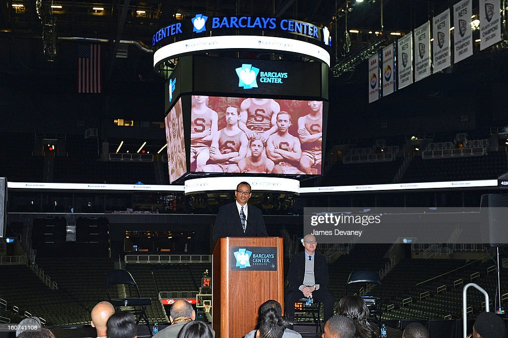 Black Fives Foundation founder Claude Johnson honors the legacy of Brooklyn's African-American basketball history through the installation of six large-scale photographs of the Black Fives at Barclays Center on February 4, 2013 in the Brooklyn borough of New York City.