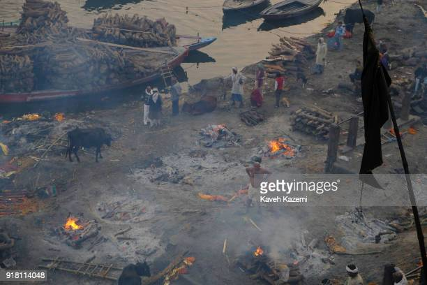 A black flag hangs high from Manikarnika Ghat durning mass cremation ceremony with multiple burning pyres seen on the ground on January 28 2018 in...