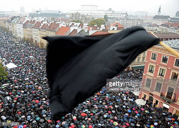 A black flag is seen as people take part in a nationwide strike and demonstration to protest against a legislative proposal for a total ban of...