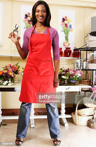 Black florist working in shop