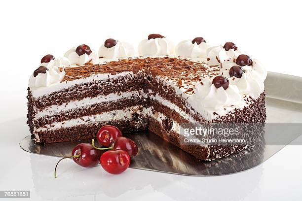 Black forest cake and fresh cherries, close-up