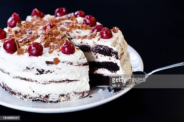 Black forest cake with whipped cream and cherries