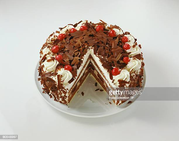 Black Forest gateau with pieces taken, close up