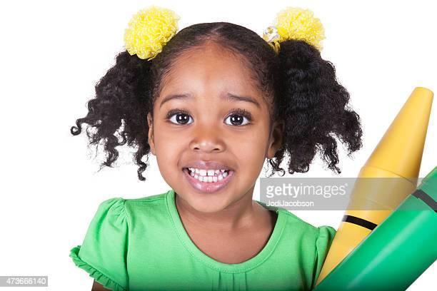 black four year old preschool girl holds toy crayons - paardenstaart haar naar achteren stockfoto's en -beelden