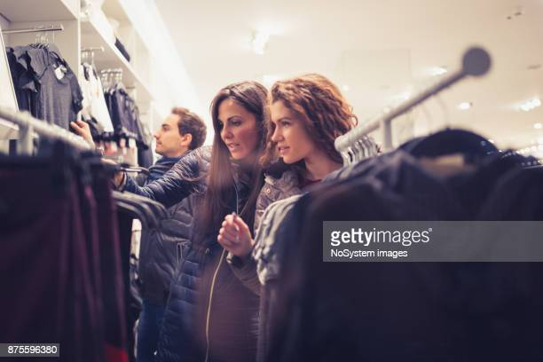 Black Friday. Best friends in shopping, choosing clothes in fashion store