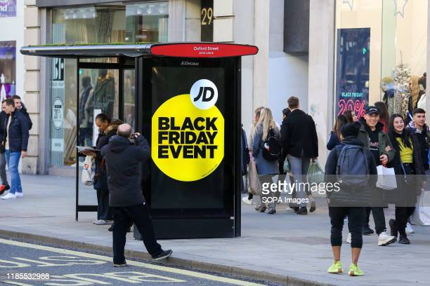 A black Friday Event Advert seen at a bus stop on Oxford Street during the Black Friday event Black Friday is a shopping event where retailers cut...