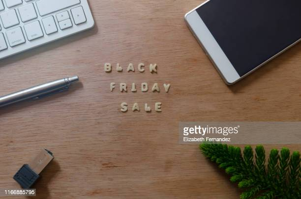 black friday sale on wooden table - black friday stock photos and pictures