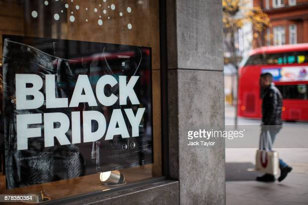 Black Friday sale sign sits in a shop window on Oxford Street on November 24 2017 in London England British retailers offer deals on their products...