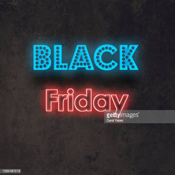 black friday sale text on in neon lights.black background - black friday imagens e fotografias de stock