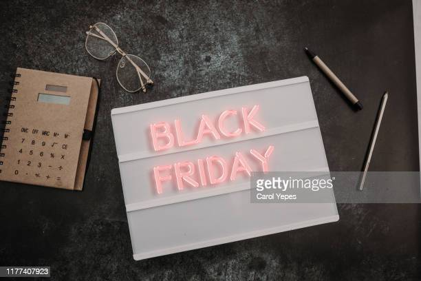black friday sale text on lightbox on black - black friday stock pictures, royalty-free photos & images