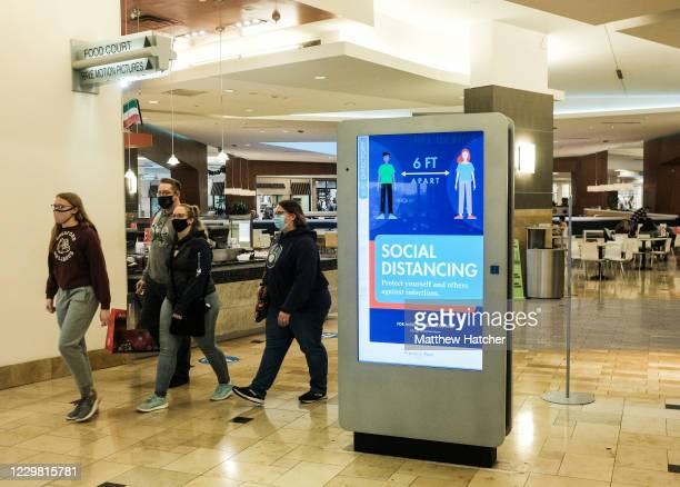 Black Friday shoppers in masks and PPE make the rounds to different stores at the Franklin Park Mall looking for Black Friday deals on November 27,...