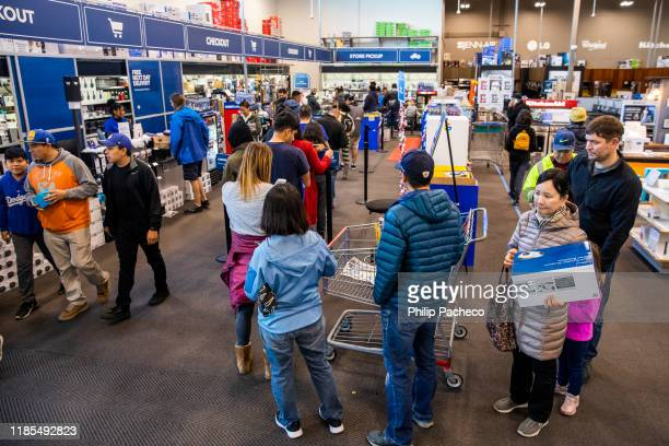 Black Friday shoppers wait to purchase goods at a Best Buy store on November 29 2019 in Emeryville United States Black Friday is traditionally the...