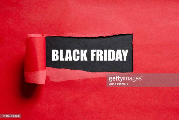 black friday text. torn red paper with copy space for text. - black friday stock pictures, royalty-free photos & images