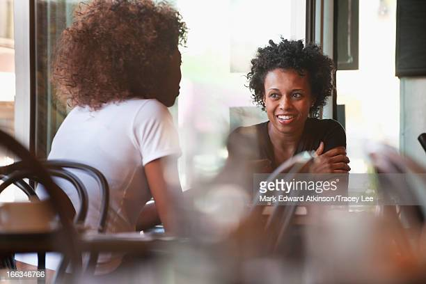 Black friends sitting together in cafe