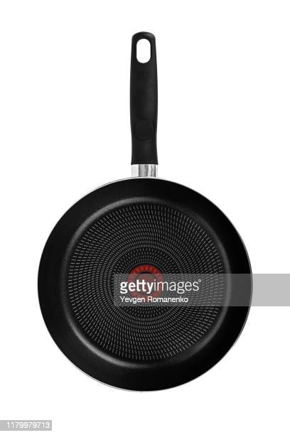 black frying pan with a non-stick teflon coating, isolated over the white background - cooking pan stock pictures, royalty-free photos & images