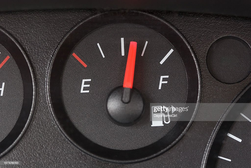 Black Fuel Gauge with Red Marker Over Half Full : Stock Photo